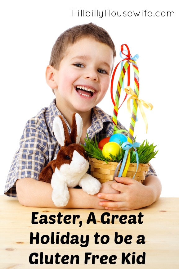 Happy little boy with an easter basket full of gluten free goodies and a stuffed bunny.