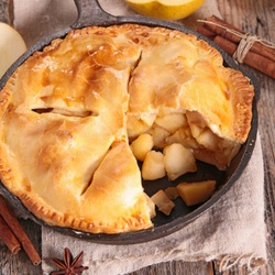 Freshly baked apple pie, shown here baked in a cast iron skillet, but could also be baked in a regular pie tin.