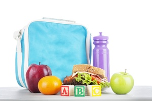 Blue lunch box, purple water bottle a sandwich and fruit