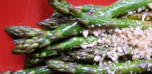 steamed asparagus topped with pine nuts.