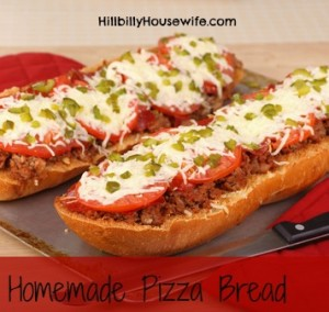 French bread pizza with hamburger pepperoni tomato and melted cheese