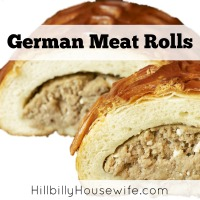 Two Bierrocks or german meat rolls filled with cooked cabbage and ground beef.