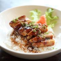 Bowl of orange chicken over rice.