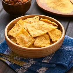 Bowl of homemade corn chips - so quick and easy to make from corn tortillas. Just cut and bake