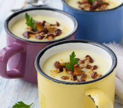 Mugs of homemade cream of mushroom and potato soups