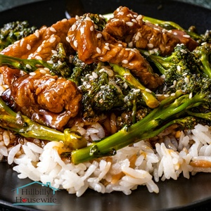 A dish of beef and broccoli made with frozen broccoli over rice.