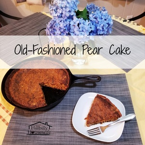 My old-fashioned pear cake recipe made with fresh pears and baked in a cast-iron skillet. Finished cake sitting on the table with blue flowers and one slice cut out and served on a white plate.
